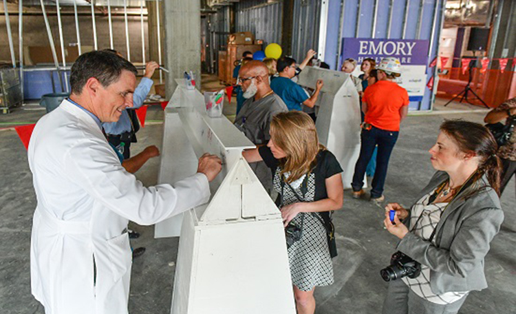 Signing a beam for the new building